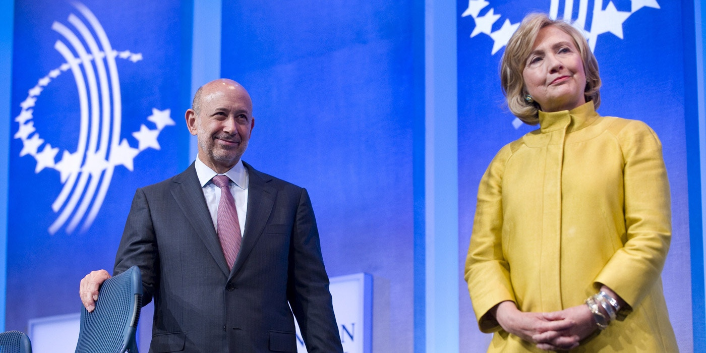 Lloyd Blankfein, Chairman & CEO, Goldman Sachs (L) stands on stage with former US Secretary of State Hillary Clinton during the 2014 Clinton Global Initiative annual meeting in New York September 24, 2014. AFP PHOTO/STEPHEN CHERNIN        (Photo credit should read STEPHEN CHERNIN/AFP/Getty Images)