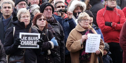 Charlie Hebdo magazine shooting. Members of the public stand in silence at a 'Je Suis Charlie' rally in the centre of Sheffield in a show of solidarity, as dozens of world leaders led a defiant march through Paris, France, in the wake of the terror attacks. Picture date: Sunday January 11, 2015. See PA story POLICE Magazine Sheffield. Photo credit should read: Dave HiggensPA Wire URN:21918842