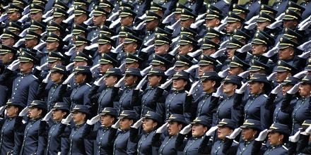 Newly graduated police officers attend a ceremony commemorating the 123 anniversary of Colombian Police at General Santander police school in Bogota, Colombia, on November 14, 2014. AFP PHOTO/Guillermo Legaria        (Photo credit should read GUILLERMO LEGARIA/AFP/Getty Images)