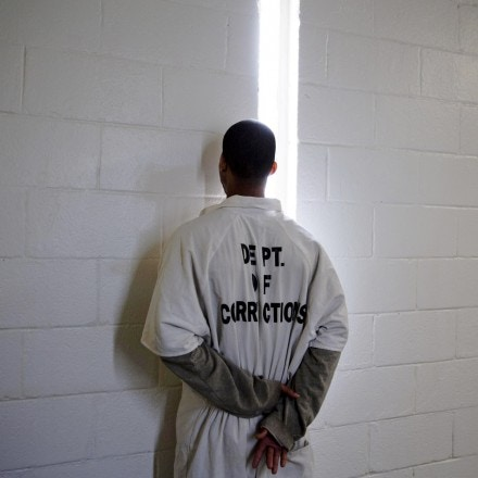 A prisoner faces the wall inside the Georgia Diagnostic and Classification Prison Tuesday, Dec. 1, 2015, in Jackson, Ga. When visitors approach, inmates in the hallways turn their backs and stand close to the walls. That makes it easy for guards to spot a guy who steps out of line. (AP Photo/David Goldman)
