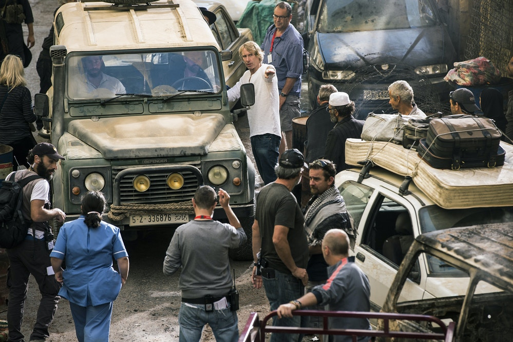 Left to right: John Krasinski, James Badge Dale and Director Michael Bay on the set of 13 Hours: The Secret Soldiers of Benghazi from Paramount Pictures and 3 Arts Entertainment / Bay Films in theatres January 15, 2016.