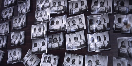 01 Jan 2000, San Quentin, California, USA --- California prison identification photographs are laid out on a table at a prison processing center in San Quentin prison. San Quentin houses California's death row, but is also the main administrative transfer center for the California prison system. --- Image by © Andrew Lichtenstein/Corbis