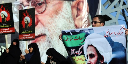 TEHRAN, IRAN - JANUARY 4: Demonstrators hold posters of Nimr Baqir al-Nimr during a protest rally against the execution of prominent Saudi Shia cleric Nimr Baqir al-Nimr by Saudi authorities, in Tehran, Iran on January 4, 2016. (Photo by Fatemeh Bahrami/Anadolu Agency/Getty Images)