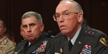 Major Gen. Geoffrey Miller, right, deputy commander for detainee operations in Iraq, testifies on Capitol Hill Wednesday, May 19, 2004, as the Senate Armed Services Committee continues its inquiry into allegations of mistreatment of Iraqi Prisoners. At left, is Gen. John Abizaid, commander of the U. S. Central Command.  (AP Photo/Dennis Cook)