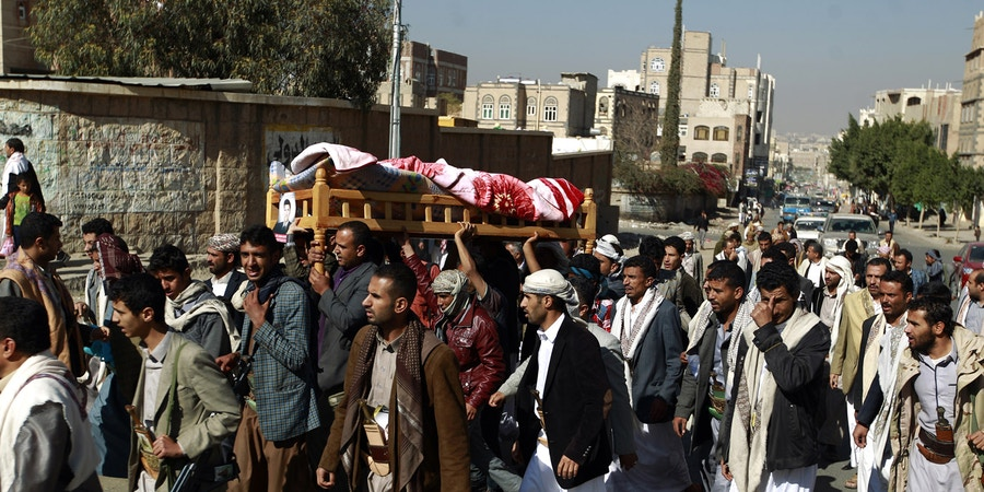 Yemeni mourners carry the body of Almigdad Mojalli, a freelance Yemeni journalist who was killed in an air raid by the Saudi-led coalition, during his funeral on the outskirts of Sanaa on January 18, 2016. Mojalli was hit by shrapnel as a missile slammed into the capital's southern Jaref suburb while he was covering air strikes, said his colleague, photojournalist Bahir Hameed. / AFP / MOHAMMED HUWAIS (Photo credit should read MOHAMMED HUWAIS/AFP/Getty Images)