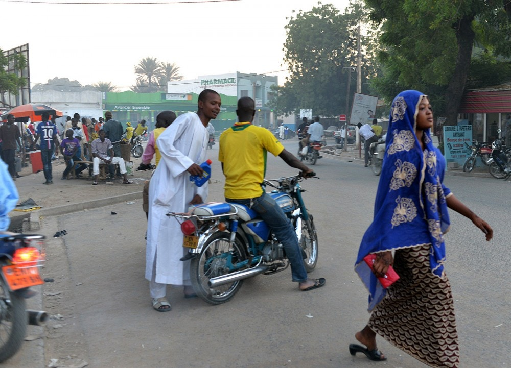 People walk along a main street in Maroua, the capital of the far northern region of Cameroon, on November 11, 2014.
