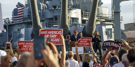 Donald Trump, president and chief executive officer of Trump Organization Inc. and 2016 Republican presidential candidate, center, speaks during a rally aboard the Battleship USS Iowa in San Pedro, California, U.S., on Tuesday, Sept. 15, 2015. Trump said Sunday that he would flesh out his tax proposals in the coming weeks, but again vowed to raise rates on hedge fund managers, who the billionaire has portrayed as
