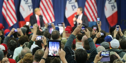 COUNCIL BLUFFS, IA - JANUARY 31:  People photograph Republican presidential candidate Donald Trump with their smart phones as he speaks to guests during a campaign rally at the Gerald W. Kirn Middle School on January 31, 2016 in Council Bluffs, Iowa. Trump and other presidential hopefuls are in Iowa trying to gain support and crucial votes for tomorrow's caucuses.  (Photo by Christopher Furlong/Getty Images)