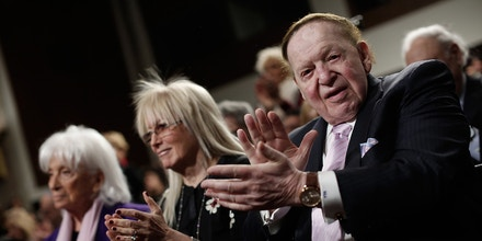 WASHINGTON, DC - MARCH 02:  American businessman Sheldon Adelson (R) applauds during a roundtable discussion on Capitol Hill with his wie Miriam Adelson (C) and Marion Wiesel (L) March 2, 2015 in Washington, DC. Elie Wiesel, Sen. Ted Cruz and Rabbi Scmuley Boteach participated in a discussion entitled