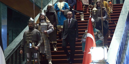 Turkish President Recep Tayyip Erdogan poses front of the 16 soldiers who represent the 16 Turkish states founded in the history during the visit of the Palestinian President Mahmoud Abbas (not seen) at the Turkish presidential palace in Ankara, on January 12, 2015. Actors dressed in the military costumes of 16 states founded throughout history by Turks staged a dress show as Palestinian President Mahmud Abbas met with his Turkish counterpart in AnkaraAFP PHOTO/ADEM ALTAN        (Photo credit should read ADEM ALTAN/AFP/Getty Images)