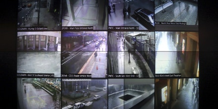 FILE - This Tuesday, Feb. 19, 2013 file photo shows part of a wall of surveillance camera video in New York. When news came of a terror attack in Paris, the New York Police Department went on high alert: Officials mobilized heavily armed teams to guard sensitive spots around the city. Detectives combed intelligence for any sign of a threat or copycat crime. And officers were sent overseas to bring back lessons from the tragedy. (AP Photo/Mary Altaffer)