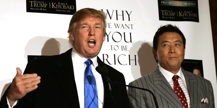 New York, UNITED STATES:  Real Estate developer and author Donald Trump (L) and author Robert Kiyosaki hold a press conference at Trump Tower on 5th Avenue 12 October 2006 for a book launching party for their new book titled