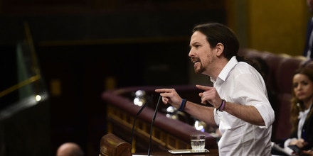 Leader of left wing party Podemos Pablo Iglesias speaks at Las Cortes in Madrid on March 2, 2016 during a parliamentary debate to vote through a prime minister and allow the country to finally get a government.The parliamentary session is a key step towards trying to unblock nearly 11 weeks of political stalemate since inconclusive December elections resulted in a hung parliament divided among four main parties -- none of which won enough seats to govern alone. / AFP / PIERRE-PHILIPPE MARCOU (Photo credit should read PIERRE-PHILIPPE MARCOU/AFP/Getty Images)