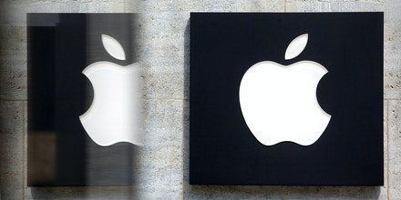 A small Apple Inc. logo sits on the doorway to the new store ahead of the opening of the unit on Kurfurstendamm Street in Berlin, Germany, on Wednesday, May 1, 2013. The Berlin Apple Inc. store is the company's 11th in the country, but the first in Germany's capital city. Photographer: Krisztian Bocsi/Bloomberg via Getty Images