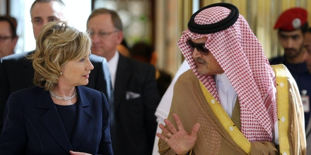 U.S. Secretary of State Hillary Rodham Clinton walks with Saudi Foreign Minister Prince Saud Al-Faisal, right, upon her arrival at King Khalid International Airport in Riyadh, Saudi Arabia, Monday, Feb. 15, 2010. (AP Photo/Hassan Ammar)
