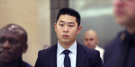 Police Officer Peter Liang, center, leaves the courtroom during a break in closing arguments in his trial on charges in the shooting death of Akai Gurley, Tuesday, Feb. 9, 2016, at Brooklyn Supreme court in New York.  Jurors are scheduled to start discussing their views of Liang's actions as soon as Tuesday. Closing arguments are expected in the morning, and deliberations are likely to begin in the afternoon. (AP Photo/Mary Altaffer)