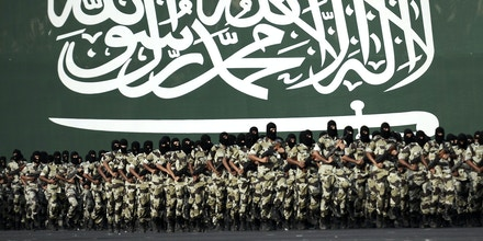 Members of the Saudi special police unit perform during a parade in Mecca, on September 28, 2014, as more than one million Muslims have arrived in the holy city in the lead up to the annual hajj pilgrimage. The hajj is one of the world's largest human gathering. AFP PHOTO/MOHAMMED AL-SHAIKH        (Photo credit should read MOHAMMED AL-SHAIKH/AFP/Getty Images)