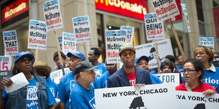 CHICAGO, IL - JUNE 22:  Fast food workers and community activists protest outside a McDonald's restaurant in the Loop on June 22, 2015 in Chicago, Illinois. The protestors were calling for an increase in the minimum wage to $15-dollars-per-hour. The demonstration was staged to coincide with the 4th hearing of the Wage Board in New York City as it debates the $15-dollar-per-hour increase for its workers.  (Photo by Scott Olson/Getty Images)