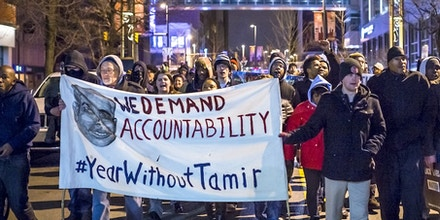 CLEVELAND, OH - DECEMBER 29: A group of protestors march on Huron Road on December 29, 2015 in Cleveland, Ohio. Demonstrators took to the street the day after a grand jury declined to indict Cleveland Police officer Timothy Loehmann for the fatal shooting of Tamir Rice on November 22, 2014. (Photo by Angelo Merendino/Getty Images)