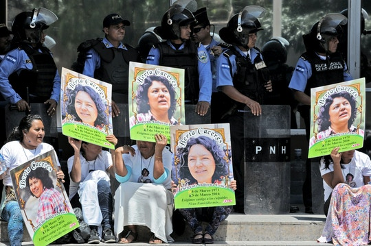 Human rights activists take part in a protest to claim justice after the murdered of indigenous activist leader Berta Caceres in Tegucigalpa on March 17, 2016. Caceres, a respected environmentalist who won the prestigious Goldman Prize last year for her outspoken advocacy, was murdered in her home on March 3, her family said.      AFP PHOTO/Orlando SIERRA. / AFP / ORLANDO SIERRA        (Photo credit should read ORLANDO SIERRA/AFP/Getty Images)
