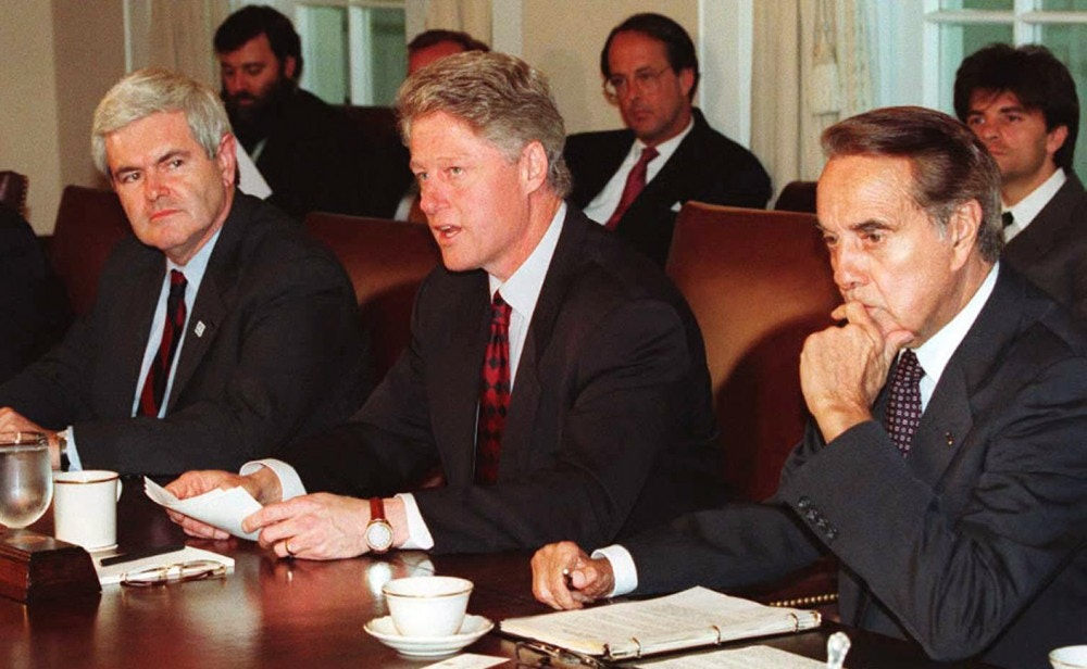 WASHINGTON, DC - APRIL 26:  US President Bill Clinton (C) sits between US House of Representatives Speaker Newt Gingrich (L) and Senate Majority Leader Bob Dole (R) during a 26 April meeting at the White House in which Clinton pushed for more federal workers to combat terrorism. Earlier today, Clinton attended the funeral of a Secret Service agent who was killed in the Oklahoma City bombing. AFP PHOTO  (Photo credit should read LUKE FRAZZA/AFP/Getty Images)