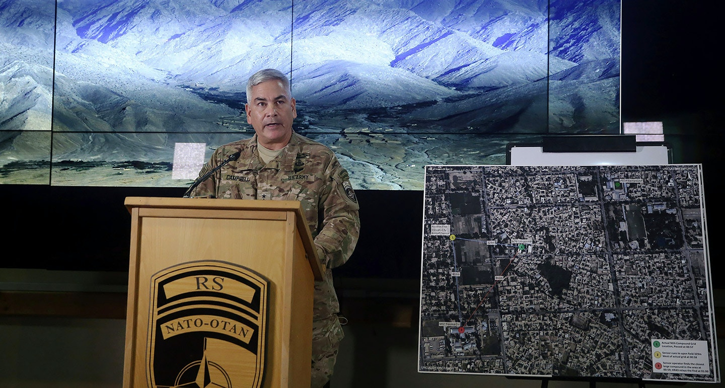 "Commander of U.S. and NATO forces in Afghanistan, General John F. Campbell stands beside a map of the northern Afghan city of Kunduz as he addresses a press conference at Resolute Support headquarters in Kabul on November 25, 2015.   A deadly air strike on a Doctors Without Borders (MSF) hospital was ""caused primarily by human error"", the US commander in Afghanistan said Wednesday, promising disciplinary action as he detailed a US investigation into the catastrophic attack.  AFP PHOTO/Massoud HOSSAINI/POOL / AFP / POOL / MASSOUD HOSSAINI        (Photo credit should read MASSOUD HOSSAINI/AFP/Getty Images)"