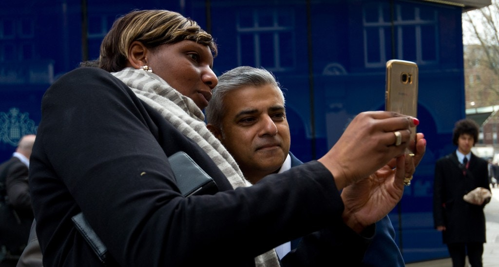 LONDON, ENGLAND - APRIL 21: Labour Mayoral Candidate Sadiq Khan poses for a selfie with members of the public during a visit to Scotland Yard on April 21, 2016 in London, England. Sadiq Khan is currently one of the main contenders running against Conservative candidate Zac Goldsmith as both parties campaign ahead of the election on May 5th. (Photo by Ben Pruchnie/Getty Images)