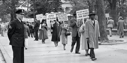 ** FILE ** In this Oct. 24, 1955 file photo, officers stand by as black religious leaders from Chicago demonstrate outside the White House in Washington against the murder of 14-year-old boy from Chicago, Ill., Emmett Louis Till. (AP Photo/File)