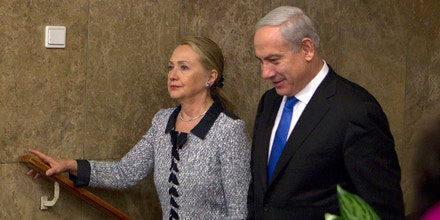 JERUSALEM, ISRAEL - NOVEMBER 20: Israel's Prime Minister Benjamin Netanyahu (R) walks with U.S. Secretary of State Hillary Clinton upon her arrival to their meeting November 20, 2012 in Jerusalem, Israel. The United States signaled today that a Gaza truce could take days to achieve after Hamas, the Palestinian enclave's ruling Islamist militants, backed away from an assurance that it and Israel would stop exchanging fire within hours.  (Photo by Baz Ratner-Pool/Getty Images)
