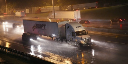 HINSDALE, IL - JUNE 10:  A truck driver navigates a rain-covered highway on the outskirts of Chicago on June 10, 2014 in Hinsdale, Illinois. Legislation introduced in the U.S. Senate that would ease restrictions on the number of hours truckers can drive each week is being questioned following a crash on the New Jersey Turnpike in which an allegedly sleep-deprived truck driver crashed into a bus, seriously injuring comedian Tracy Morgan and killing Morgan's friend, fellow comedian James