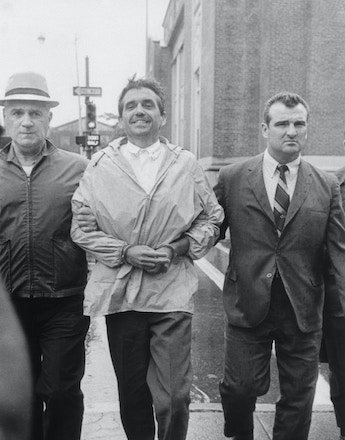 (Original Caption) 8/11/1970- Providence, RI- The Reverand Daniel J. Berrigan is taken into the Federal Building in Providence on August 11th, after he was found at a summer home on Block Island. Berrigan, convicted of burning draft records, went underground in April, to avoid imprisonment on the draft-burning conviction.
