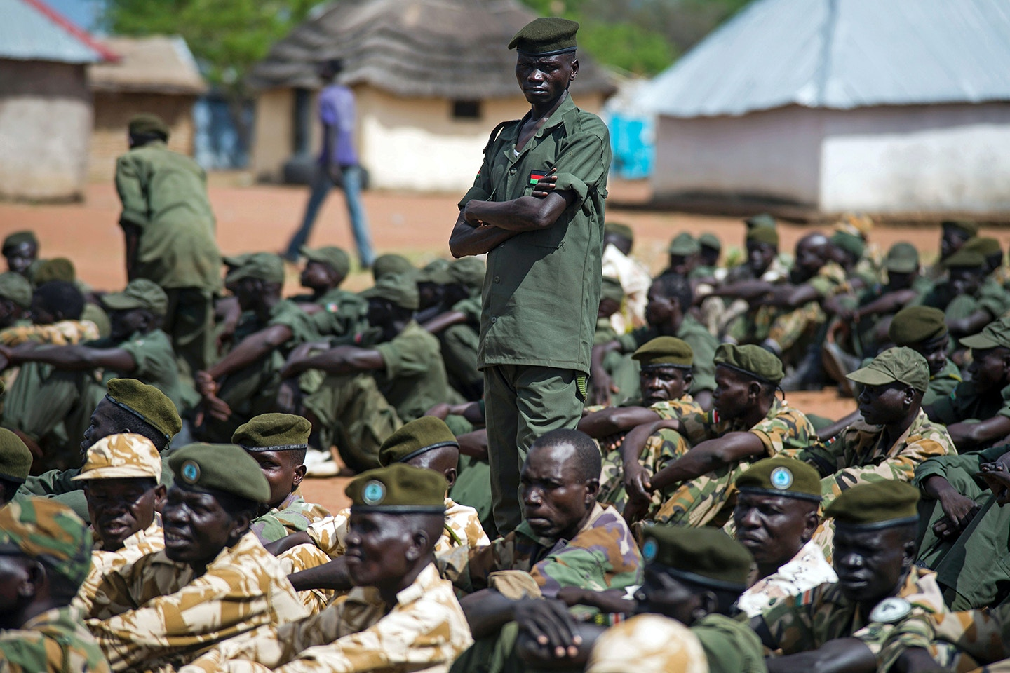 Troops of the South Sudanese army (SPLA) wait for the arrival of members of the Ceasefire and Transitional Security Arrangements Monitoring Mechanism (CTSAMM) at the Pillbam military base in Juba on April 16, 2016.<br /> The SPLA permitted the CTSAMM to visit their military sites and verify whether or not the capital Juba has been demilitarized as required by the August 2015 peace agreement which President Salva Kiir's government signed with the armed opposition faction led by First Vice President designate Riek Machar. CTSAMM is responsible for monitoring compliance and reporting directly to the Joint Monitoring and Evaluation Commission (JMEC) on the progress of the implementation of the Permanent Ceasefire and Transitional Security Arrangements.  / AFP / ALBERT GONZALEZ FARRAN        (Photo credit should read ALBERT GONZALEZ FARRAN/AFP/Getty Images)