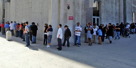 In this March 18, 2010 file photo, people line up outside the Metropolitan Courthouse, which handles traffic citations and other matters, in downtown Los Angeles. Gov. Jerry Brown is proposing an amnesty program for Californians who can't afford to pay off spiraling traffic fines and court fees that have led to millions of driver's licenses being suspended. (AP Photo/Damian Dovarganes, File)
