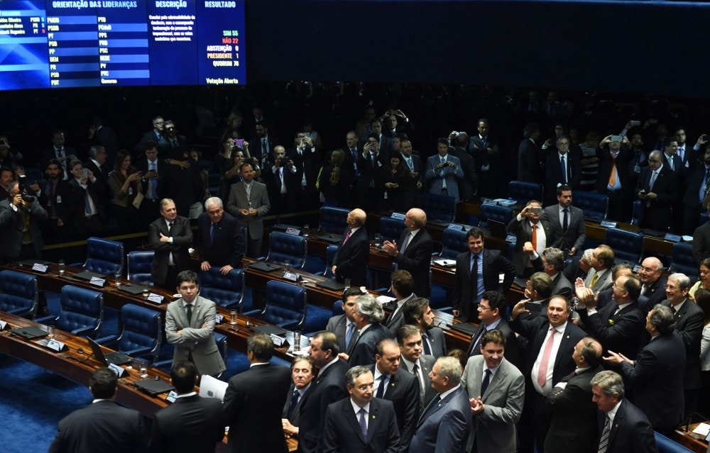 The final score of a Senate vote with an overwhelming 55-22 on suspending Brasilian President Dilma Rousseff and launching an impeachment trial is pictured on a large screen inside the Senate in Brasilia on May 12, 2016.Brazilian President Dilma Rousseff was suspended on May 12 to face impeachment, ceding power to her vice-president-turned-enemy Michel Temer in a political earthquake ending 13 years of leftist rule over Latin America's biggest nation. / AFP / EVARISTO SA (Photo credit should read EVARISTO SA/AFP/Getty Images)