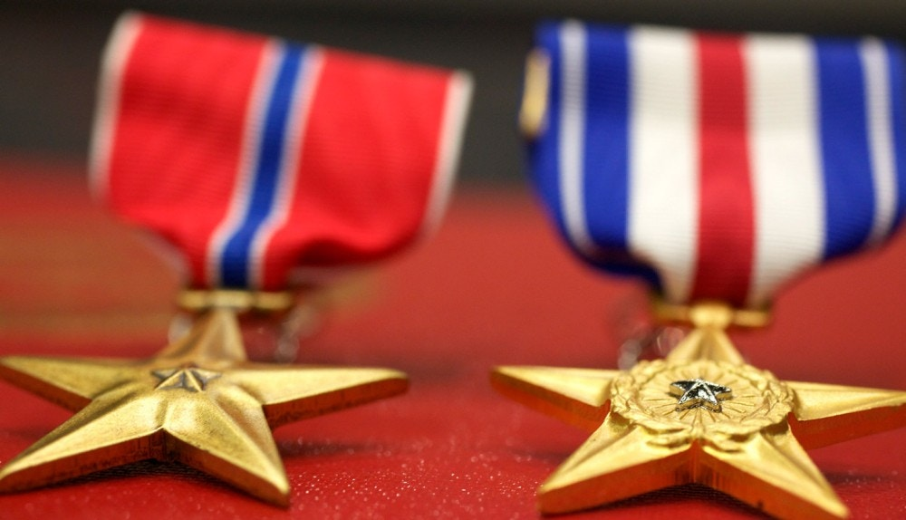 The Bronze and Silver Star sit on display at an award ceremony where they will be presented to Marines with Marine Corps Forces Special Operations Command at Camp Pendleton, Calif., March 12. Staff Sgt. Andrew K. Thompson received the military's third highest award, the Silver Star. Staff Sgt. Maurice Scott received the fourth highest award, the Bronze Star, at Camp Pendleton, Calif., March 12. Thompson, from Bismark, N.D., led Marines and Afghans successfully into an attack under intense fire to overcome the enemy, according to the citation. Scott, 33, from Chicago, employed supporting aircraft to break lines and hinder enemy activity during a night helicopter raid, according to the citation.