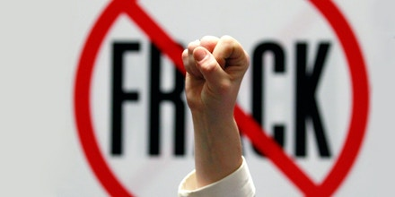 FILE - In this Jan. 23, 2012 file photo, Gillie Waddington of Enfield, N.Y., raises a fist during rally against hydraulic fracturing of natural gas wells at the Legislative Office Building in Albany, N.Y. President Barack Obama the f- word during his recent State of the Union speech nor did he mention the technology used to get it, known commonly as fracking. That's because the word has become a lightning rod.  (AP Photo/Mike Groll, File)