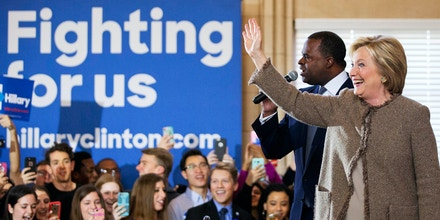 Democratic presidential candidate, Hillary Clinton, right, steps on stage with Atlanta Mayor Kasim Reed at a campaign event at the Old City Council Chambers in City Hall Friday, Feb. 26, 2016, in Atlanta. (AP Photo/David Goldman)