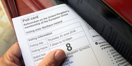 A Poll card for voting in the UK's June 23 referendum on Europe, is arranged for a photograph in Belfast, Northern Ireland, on June 22, 2016.Rival sides threw their efforts into the final day of campaigning Wednesday, on the eve of Britain's vote on EU membership that will shape the future of Europe. / AFP / PAUL FAITH (Photo credit should read PAUL FAITH/AFP/Getty Images)