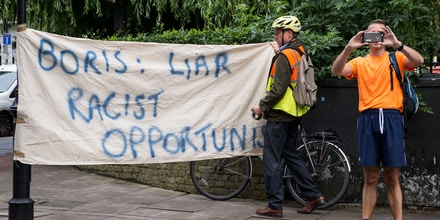 A man holds up a banner outside the home of former London Mayor, Boris Johnson, in London on June 30, 2016. Brexit campaigner Michael Gove announced a surprise bid Thursday to become Britain's next prime minister, in a blow for his close ally Boris Johnson's chances, as turmoil gripped both the country's main political parties after the shock vote to leave the EU. / AFP / CHRIS J RATCLIFFE (Photo credit should read CHRIS J RATCLIFFE/AFP/Getty Images)