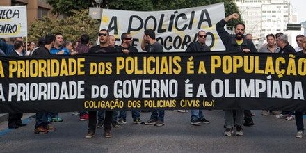 Civil police officers threatening to go on strike demonstrate against the government for arrears in their salary payments, in Rio de Janeiro, Brazil, June 27, 2016, tEarlier this month, Rio state authorities declared a
