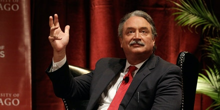 Alex Castellanos, Republican media consultant, political commentator, shares a stage with pundits during a panel discussion,
