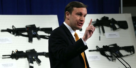 WASHINGTON, DC - JANUARY 24:  U.S. Senator Chris Murphy (D-CT) speaks next to a display of assault weapons during a news conference January 24, 2013 on Capitol Hill in Washington, DC. U.S. Senator Dianne Feinstein (D-CA) announced that she will introduce a bill to ban assault weapons and high-capacity magazines capable of holding more than 10 rounds to help to stop gun violence.  (Photo by Alex Wong/Getty Images)