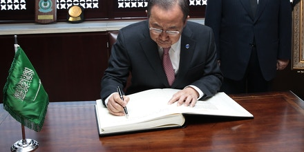 NEW YORK, NY - JANUARY 26:  In this handout image provided by the United Nations, United Nations Secretary General Ban Ki-moon signs the book of condolence for the late King of Saudi Arabia watched by H.E. the Permanent Representative of the Kingdom of Saudi Arabia to the United Nations in New York, Ambassador Abdallah Y. Al-Mouallimi on January 26, 2015 in New York City.  Saudi King Abdullah died in the early hours of Friday January 23, 2015, aged 90. He ascended to the throne in 2005 after the death of his half-brother King Fahd and is succeeded by his half-brother, 79-year-old, King Salman bin Abdulaziz al-Saud.  (Photo by Evan Schneider/UN Photo via Getty Images)