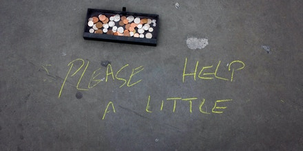 Busker's message in chalk and donation coins on pavement in Trafalgar Square. Cash has been dropped into a tray on the pavement in this pedestrian zone on the north part of the square, outside the National Gallery. A street artist is busy drawing pictures in chalk on the paving slabs that serve as framed pictures. Asking for kind donations for his art and to help support his meagre lifestyle. (Photo by In Pictures Ltd./Corbis via Getty Images)