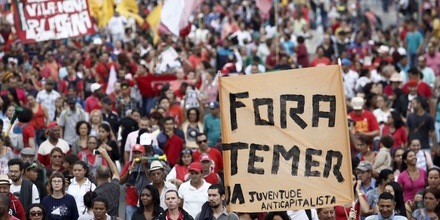 CORRECTION - Supporters of Brazilian suspended President Dilma Rousseff hold a protest against acting president Michel Temer, in Sao Paulo on May 22, 2016.Rousseff was suspended from office to face an impeachment trial on charges of tweaking government accounts to make them look better as she sought re-election in 2014. / AFP / Miguel Schincariol / The erroneous mention[s] appearing in the metadata of this photo by Miguel Schincariol has been modified in AFP systems in the following manner: [in Sao Paulo] instead of [in Belo Horizonte]. Please immediately remove the erroneous mention[s] from all your online services and delete it (them) from your servers. If you have been authorized by AFP to distribute it (them) to third parties, please ensure that the same actions are carried out by them. Failure to promptly comply with these instructions will entail liability on your part for any continued or post notification usage. Therefore we thank you very much for all your attention and prompt action. We are sorry for the inconvenience this notification may cause and remain at your disposal for any further information you may require. (Photo credit should read MIGUEL SCHINCARIOL/AFP/Getty Images)