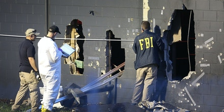 ORLANDO, FL - JUNE 12:  FBI agents investigate near the damaged rear wall of the Pulse Nightclub where Omar Mateen allegedly killed at least 50 people on June 12, 2016 in Orlando, Florida. The mass shooting killed at least 50 people and injuring 53 others in what is the deadliest mass shooting in the countryÕs history.  (Photo by Joe Raedle/Getty Images)