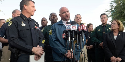 FBI assistant special agent in charge Ron Hopper, center, answers questions from reporters after a multiple shooting at a nightclub in Orlando, Fla., Sunday, June 12, 2016. Listening are Orlando Police John Mina, left, and Orange County Mayor Teresa Jacobs. (AP Photo/Phelan M. Ebenhack)