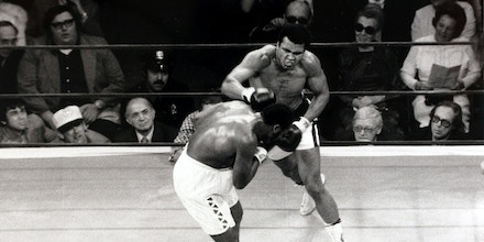 Sport, Boxing, World Heavyweight Championship, 8th March 1971, Madison Square Garden, New York, USA, Joe Frazier beat Muhammad Ali, The unsuccessful challenger Muhammad Ali (right) throws an overhand right as Joe Frazier covers up in the middle of the ring, Joe Frazier beat fellow American challenger Muhammad Ali on points over 15 rounds to retain his title and remain Heavyweight Champion of the World  (Photo by Popperfoto/Getty Images)