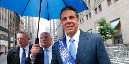 New York Gov. Andrew Cuomo, right, approaches a group of reporters and photographers before marching in the annual Celebrate Israel parade along Fifth Avenue, Sunday, June 5, 2016, in New York. (AP Photo/Kathy Willens)