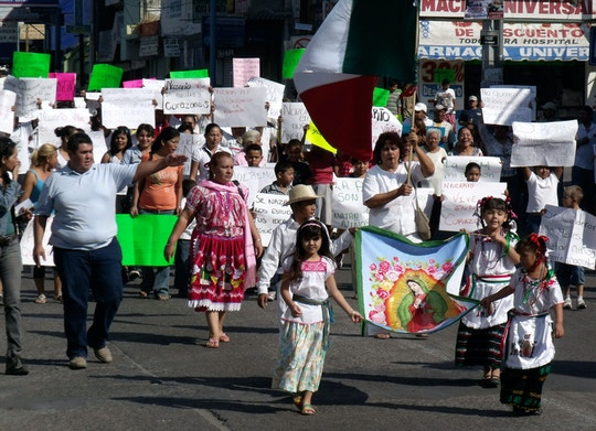 "People demonstrate in favor of the drug trafficking organization ""La Familia"" and its late leader Nazario Moreno Gonzalez in Apatzingan, Mexico, Sunday Dec. 12, 2010.  Moreno was killed on Thursday in Apatzingan during two days of shootouts between gunmen and federal police, according to the government.  (AP Photo/Primera Plana)"